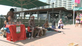 Local Band Sydney. SYDNEY, AUSTRALIA, MAR 22, 2009:  Local band performing with aborigines and a didgiridoo player on the promenade at the Harbor Bay Area in stock video footage