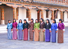 Local Bhutanese girls rehearsing a dance sequence for an upcoming festival. Local Bhutanese girls in their traditional attire, called Kira, rehearsing an dance Stock Photography