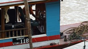 Local boat captain and crew are controling the boat. Luang prabang, Laos - AUGUST 8, 2015: local boat captain and crew are controling the boat apart from ship stock video footage