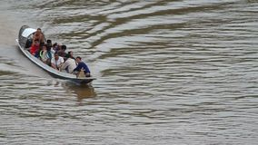 Local boat carrying people across Mekong river. Luang prabang, Laos - AUGUST 5, 2015: local boat carrying people across Mekong river on AUGUST, 2015 in luang stock footage