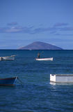 Local boat with fisherman at Mauritius Island Royalty Free Stock Image