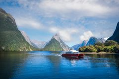 A Boat Cruise at Milford Sound, New Zealand. A local boat at Freshwater Basin at Milford Sound in the morning, going towards Southern Discoveries Marina. Milford Royalty Free Stock Image