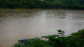 Local boat near the bank of Mekong river stock footage