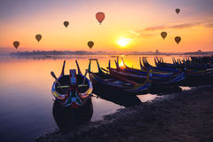 The local boat in taungthaman lake near U Bein bridge, The longe. St teak bridge in the world, Mandalay Myanmar Stock Photo