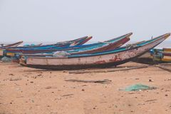 Local boats being parked at the coastal beach mangalore area Stock Image