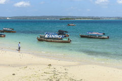 Local boats next to Prison Island Beach Stock Image