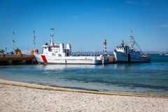 Local boats relying in a nice blue water beach in Baja California, Mexico. Royalty Free Stock Image
