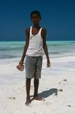 A local boy collecting conches, Zanzibar Royalty Free Stock Images