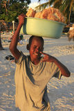 Local boy selling bread at Boca Chica beach Royalty Free Stock Photography