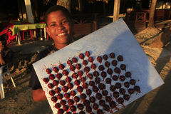 Local boy selling sweets  at Boca Chica beach Royalty Free Stock Images