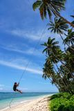 Local boy swinging on a rope swing in Lavena village, Taveuni Is Royalty Free Stock Image