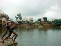 Local boys all set to jump in the pond. Boys jumping in the pond at Vrindavan to enjoy swim Stock Photos