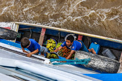 Local boys selling fruit on the Amazon River, Brazil Stock Photo