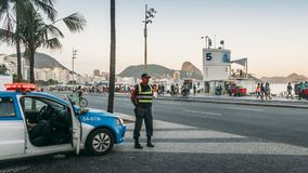 Local Brazilian policemen watch over locals and tourists in Copacabana. Rio de Janeiro, Brazil - Dec 17, 2017: Local Brazilian policemen watch over locals and royalty free stock image