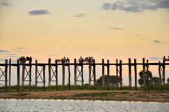 Local Burmese resting at the U-bein bridge during sunset Royalty Free Stock Images