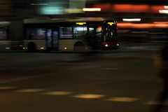 Local bus in Barcelona moving on speed in the night. City Royalty Free Stock Image