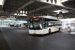 Local bus HTM Buzz at the station of Den Haag Centraal number 1012 on temporary line 61 heading Scheveningen. Local bus HTM Buzz at the station of Den Haag stock images
