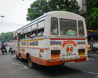 A local bus running on street in Kolkata, India Royalty Free Stock Photo
