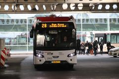 Local bus at the station of Den Haag Centraal number2002 line 28 of HTM Buzz heading Zuiderstrand.  stock images