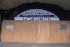 Boarded up shop under the Arches in Brixton,UK. royalty free stock photos