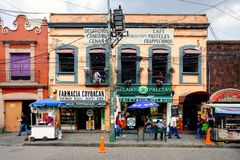 Local businesses at a colorful colonial building in Coyoacan in Mexico City. MEXICO CITY, MEXICO - DECEMBER JULY 13, 2018 : Local businesses at a colorful royalty free stock image