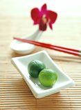 Local calamansi limes in dipping bowl Stock Images