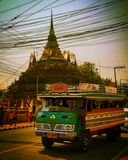Local carpool. Traditional minibus with ancient pagoda background royalty free stock photography