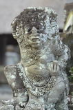 Local carved stone statue in Bali Asia Indonesia Royalty Free Stock Photos