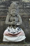 Local carved stone statue in Bali Asia Indonesia Stock Image