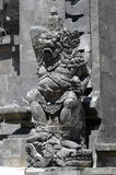 Local carved stone statue in Bali Asia Indonesia Royalty Free Stock Photography