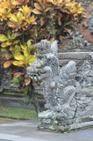 Local carved stone statues in Bali Asia Indonesia. Typical Local carved stone temple statues in Bali Asia Indonesia Stock Images