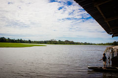 Local child fishing at Amazon River.  Royalty Free Stock Photography