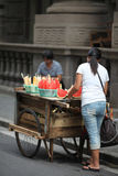 Local Chinese. A local Chinese woman hawker in Shanghai city.  Using the most basic tools as her mobile store, her stock includes fresh honey dew and water melon Royalty Free Stock Images