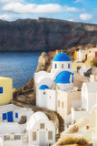 Local church with blue cupola in Oia, Santorini Royalty Free Stock Photography