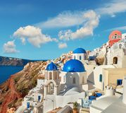 Local church with blue cupola in Oia, Santorini, Greece, panoram Stock Images