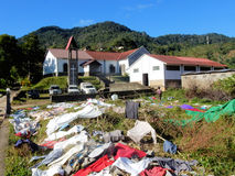Madagascar, Local church with washed colorful clothes drying on the grass and bushes Stock Photography