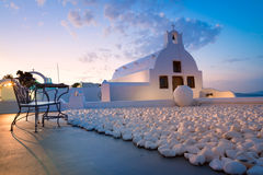 Local church in Oia village in Santorini Island early in the mor Stock Photo