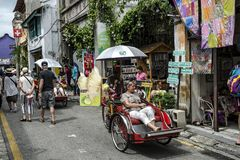 Tourists at Armenian Street, a heritage road with a lot of tourist attractions, Penang, Malaysia stock photography