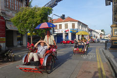 Local citizen cycling his trishaw to serve tourists to visit Pen Stock Photography