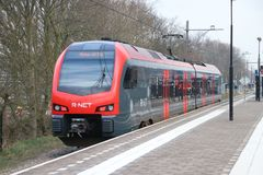Local commuter type FLIRT running for R-NET between Gouda and Alphen aan den Rijn in the Netherlands. The route is bad famous by a lot of delays and royalty free stock images