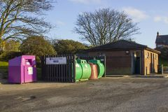 A local council glass and clothing recycling point in Bangor County Down northern Ireland. An example of a local council glass and clothing recycling point in royalty free stock images
