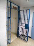 Jail cell. A local county small town jail cell in a police station Stock Photos