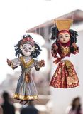 Local crafts and souvenir of traditional puppets hanging for sale stock images
