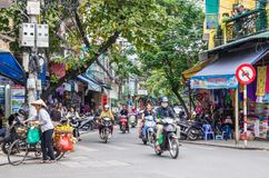 Free Local Daily Life And View Of Busy Traffic With Motorbikes In Hanoi Old Quarter, Capital Of Vietnam.People Can Seen Exploring It. Royalty Free Stock Photography - 106009627