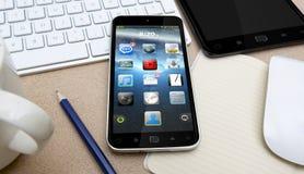 Local de trabalho com telefone celular Fotos de Stock Royalty Free