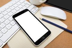 Local de trabalho com telefone celular Fotografia de Stock