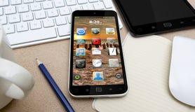 Local de trabalho com telefone celular Imagens de Stock Royalty Free