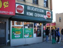 Local Delicatessen In Queens New York. Old fashioned Delicatessen located in Queens New York with kids hanging out in front of store stock photo