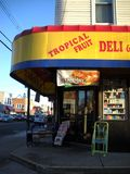 Local Delicatessen In Queens New York. Old fashioned Delicatessen located in Queens New York with signs stock images