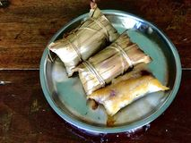 Local dessert from southern Thailand made of grilled sticky rice stuffed with banana Stock Photos